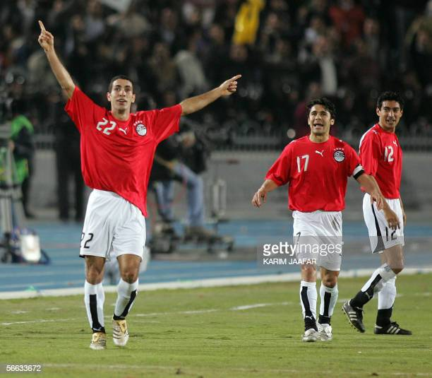 Egyptian players Mohammed Abu Terika jubilates with Hasan Kamel Ahmad and Mohammad Barakat during the opening football match of the African Nations...