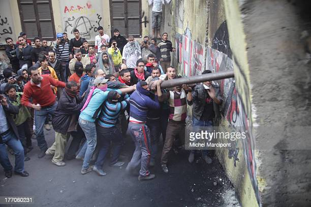 Cairo, Egypt - Egyptian police use tear gas against tahrir protesters, who tried to bring down the cement wall that bans them from reaching the...
