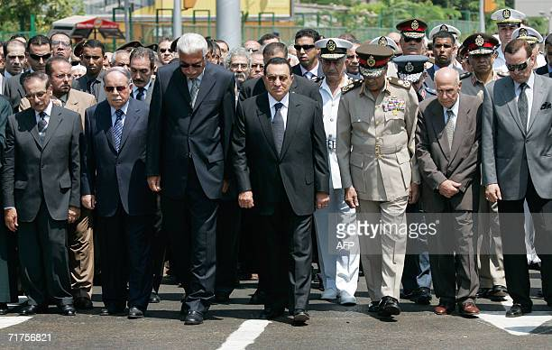 Egyptian President Hosni Mubarak leads a military funeral procession for Egyptian novelist and Nobel laureate Naguib Mahfouz in Cairo 31 August 2006...
