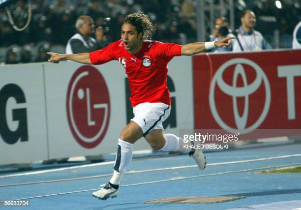 Egyptian star striker Ahmad 'Mido' Hossam celebrates after scoring the first goal against Libya during the opening football match at the African...