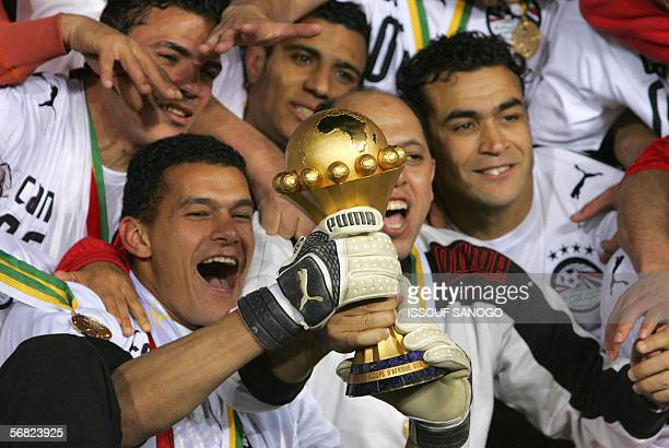 Egyptian team members celebrate after their team won against the Ivory Coast Elephants 42 in penalties in the final game of the African Nations Cup...