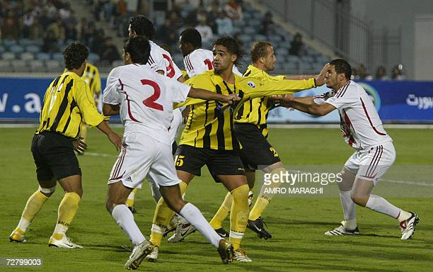 Egyptian Zamalek team players and Algerian Bordj Arreridj team players fight before a penalty shot during their first round Arab Chanmpions League...