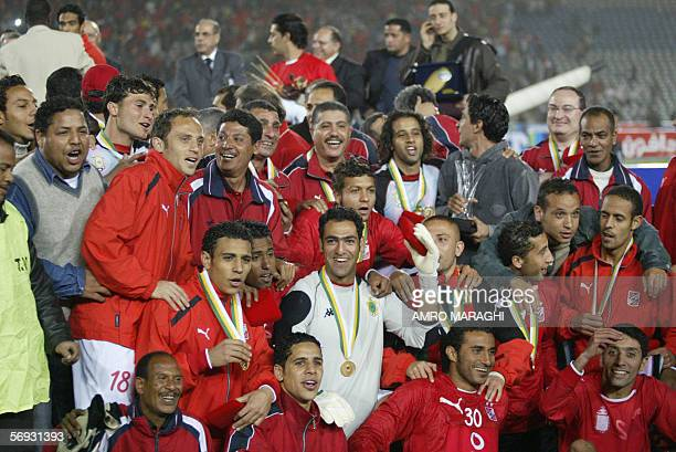 Egypt's AlAhly club players celebrate after winning Africa Super Cup against the Royal Armed Forces club of Morocco 24 February 2006 in Cairo AlAhly...