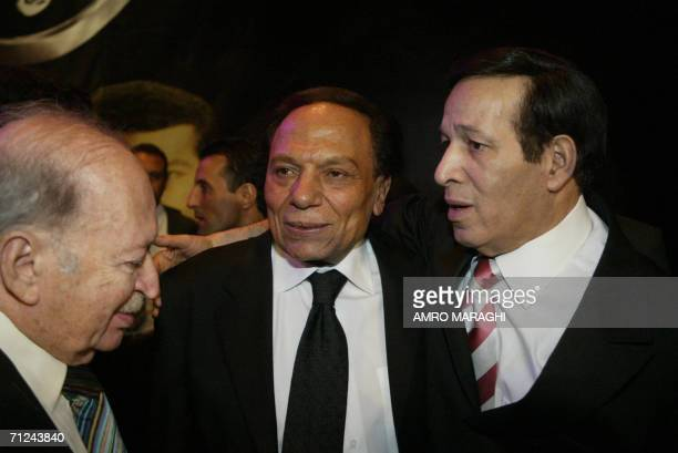 Egypt's veteran comedian Adel Imam chats with theatre director Samir Khafaga and actor Said Saleh during the official premiere of the controversial...