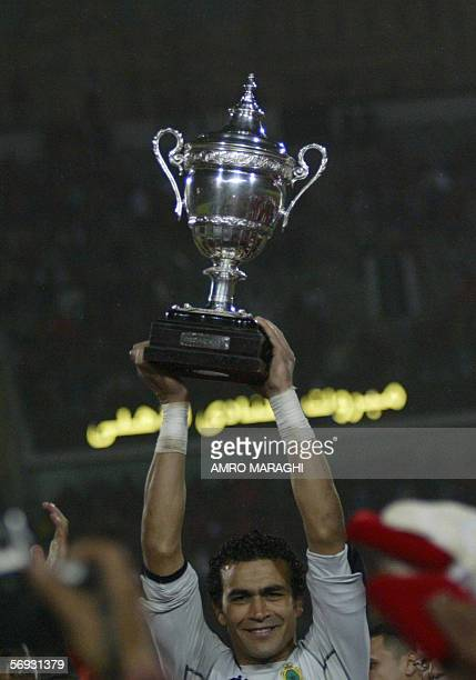 Essam AlHadary of Egypt's AlAhly club holds up the African Super Cup after winning against the Royal Armed Forces club of Morocco 24 February 2006 in...