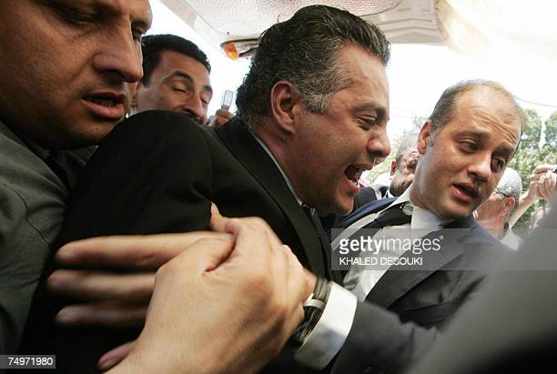 Gamal and Ahmad Marwan sons of Egyptian billionaire Ashraf Marwan react during their fathers funeral services in Cairo 01 July 2007 The controversial...