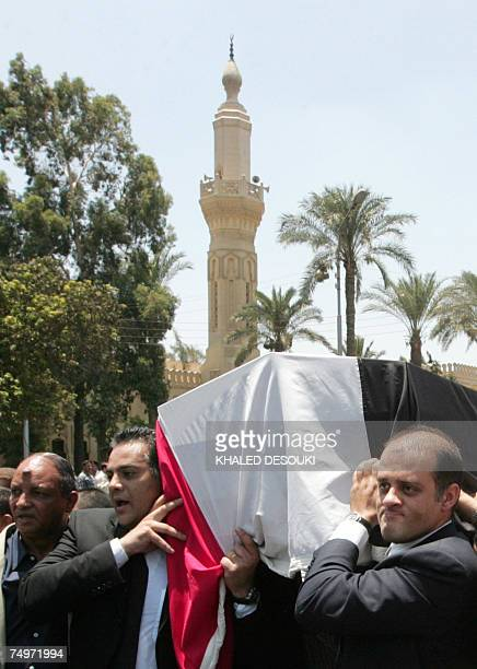 Gamal and Ahmad Marwan sons of Egyptian billionaire Ashraf Marwan carry their father's coffin at his funeral in Cairo 01 July 2007 The controversial...