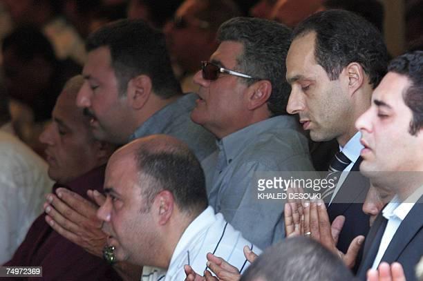Gamal Mubarak son of Egyptian President Hosni Mubarak prays during the funeral of Egyptian billionaire Ashraf Marwan in Cairo 01 July 2007 The...