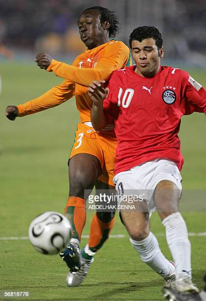 Ivory Coast defense Etienne Boka player in Strasbourg and Egyptian forward Emad Moteb compete for a ball during overtime of the final game between...