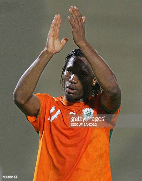 Ivory Coast's Chelsea team player Didier Drogba applauds at the end of the knockout round football game between Ivory Coast and Libya at the African...