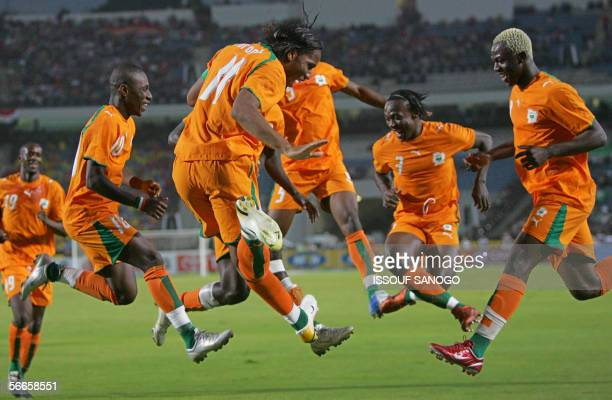 Ivory Coast's Chelsea team player Didier Drogba celebrates with other teammates his goal during the first half of the knockout round football game...