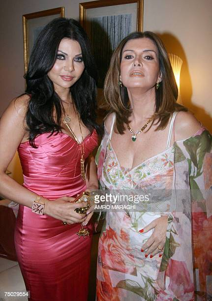 Lebanese singer Haifa Wehbe and Egyptian actress Mervat Amim pose for a photograph at Cairo Opera House during the premiere of Egyptian movie Murjan...