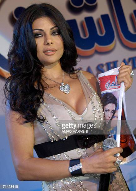 Lebanese singer Haifa Wehbi holds a copy of Shashati in Cairo late 11 July 2006 The Egyptian magazine honored Wehbi at a special event where she also...