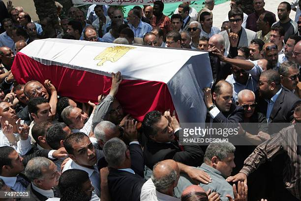 Mourners attend the funeral of Egyptian billionaire Ashraf Marwan in Cairo 01 July 2007 The controversial celebrity allegedly acted as a secret agent...