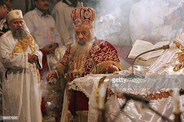 Pope Shenouda III leads the Christmas mass held at the Coptic Cathedral of Saint Marcos late 06 January 2006 in Cairo The mass usually attended by...