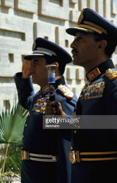 Pres Anwar Sadat and Vice Pres Husni Moubarak during military parade