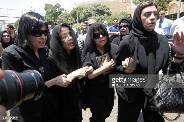 Relatives of Egyptian billionaire Ashraf Marwan react during his funeral services in Cairo 01 July 2007 The controversial celebrity allegedly acted...