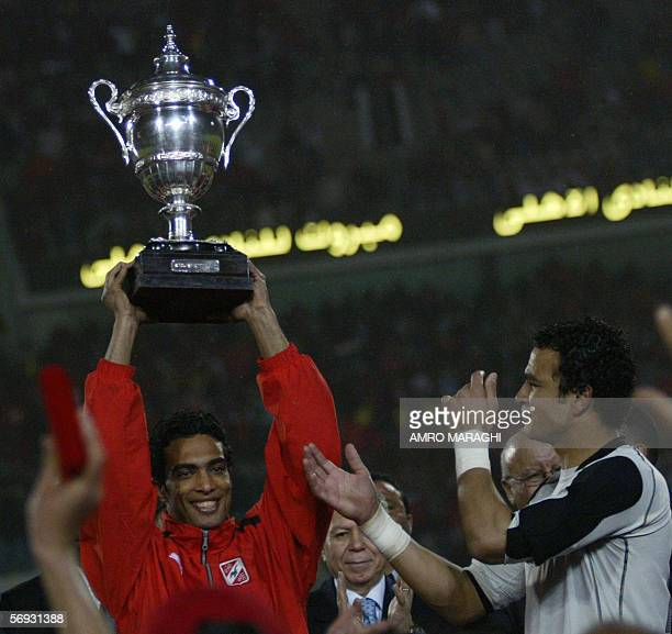 Shadi Mohammed and Essam AlHadary of Egypt's AlAhly club the African League Champion hold up the African Super Cup after winning against the Royal...