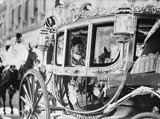 8/9/1937 Cairo Egypt Smiling broadly 18yearold King Farouk of Egypt is pictured in the State Coach riding to his recent investiture as monarch of the...