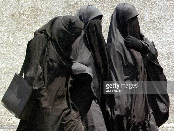 File picture dated 23 July 1999 shows fundamentalist Muslim women wearing the niqab, or full face veil, as they walk to Friday prayers at a mosque in...