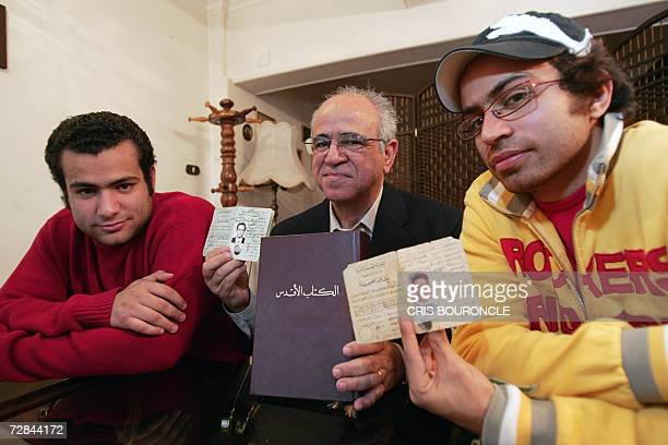 TO GO WITH AFP STORY BY JAILAN ZAYAN Egyptian Bahai Labib Iskander Hanna holds the Bahai KitabiAqdas and his official identification document while...
