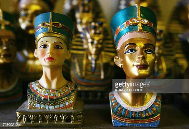 TO GO WITH AFP STORY BY JOELLE BASSOUL Figurines of Queen Nefertiti wife of the Egyptian Pharaoh Amenhotep IV are displayed at a shop in Cairo 17...