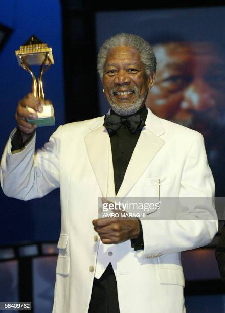 US actor Morgan Freeman hold up his honorary award during the closing ceremony of the 29th Cairo Film Festival at the Opera House late 09 December...