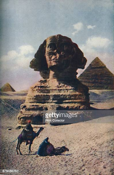 Cairo. For close upon 5000 years the enigmatic Sphinx of Gizeh, a human-headed couchant lion. Has gazed the Nile Valley', c1920. The Great Sphinx of...