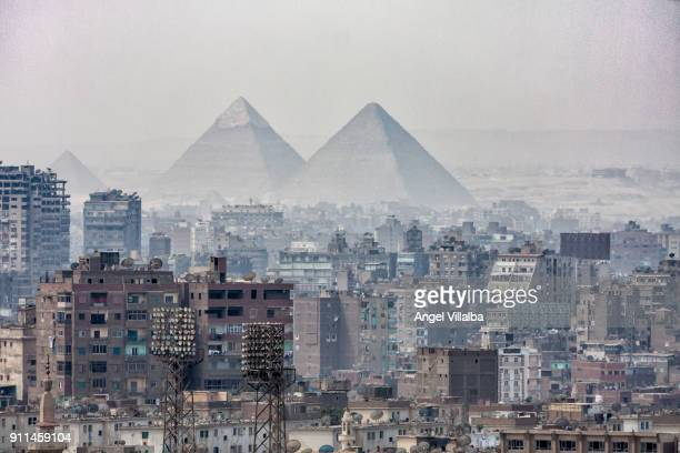 cairo. pyramids - pyramid shapes around the house stock pictures, royalty-free photos & images