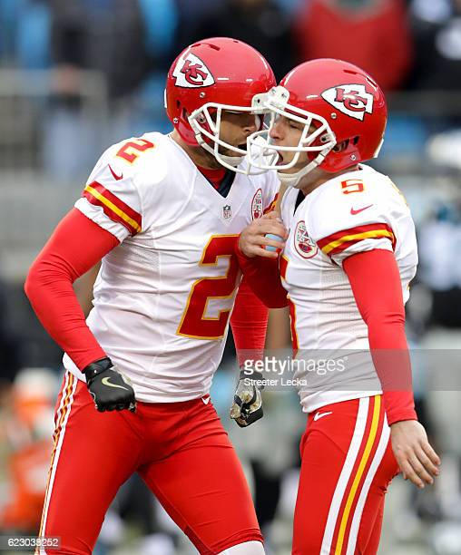 Cairo Santos celebrates after kicking a game winning field goal with teammate Dustin Colquitt of the Kansas City Chiefs to defeat the Carolina...