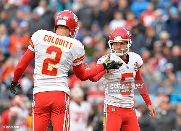 Cairo Santos celebrates with Dustin Colquitt of the Kansas City Chiefs after kicking a field goal against the Carolina Panthers during the game at...
