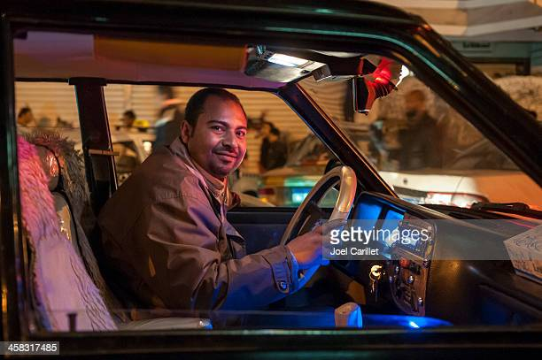 cairo taxi driver behind wheel at night in egypt - taxi driver stock photos and pictures