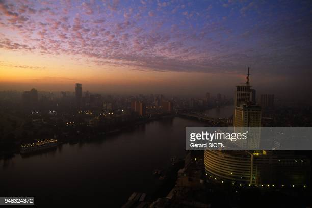 Cairo The capital View on the Nile at dusk in the front tne television tower across the island of Zamalek Egypt