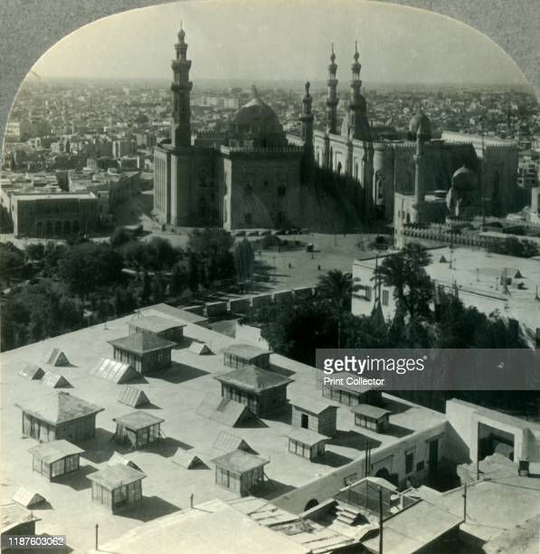Cairo the City of Romance NW from Saladin's Citadel Egypt' circa 1930s View of the MosqueMadrassa of Sultan Hassan built between 13561363 by Sultan...