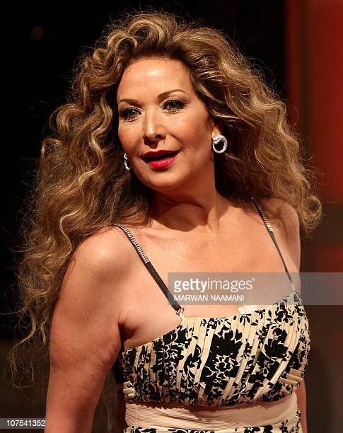 Cairobased Syrian actress Raghda poses on the red carpet upon her arrival to attend the opening ceremony of the Dubai International Film Festival in...