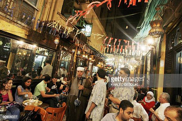 Cairo's landmark Fishawi cafe in the Egyptian capital's Islamic quarter is packed with customers late on September 17 on the eve of the last Friday...