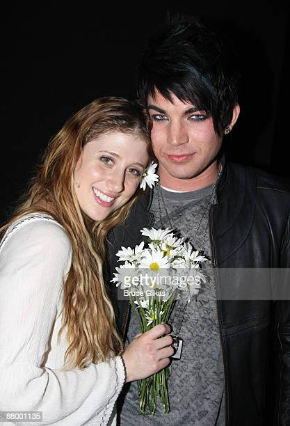 Caissie Levy and Adam Lambert pose backstage at the hit revival of 'Hair' on Broadway at The Al Hirshfeld Theater on May 26 2009 in New York City...
