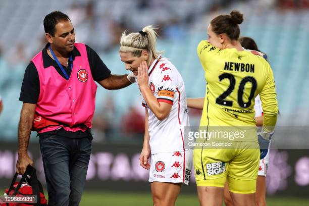 Caitiln Cooper of the Wanderers leaves the field after being struck in the head by the ball during the round four W-League match between Sydney FC...