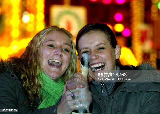 Caitlan Christie and Connor Watson start their Hogmanay celebrations early in Princes street Edinburgh Saturday December 31 2005 The selfstyled home...