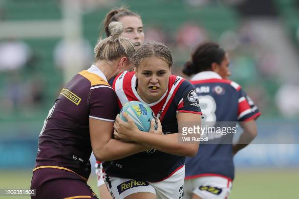 Caitlan Johnston of the Roosters is tackled by Meg Ward of the Broncos during Day 2 of the 2020 NRL Nines at HBF Stadium on February 15, 2020 in...