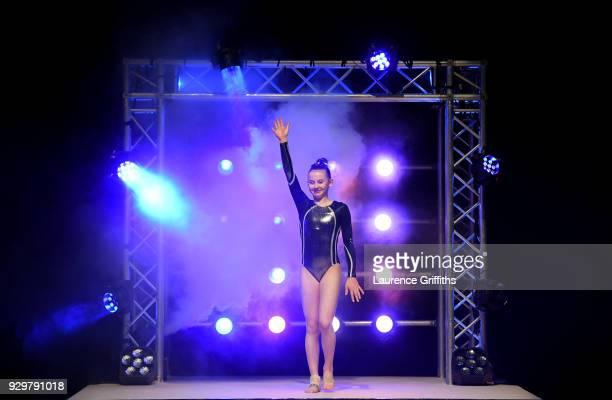 Caitlan Williams of Robin Hoood Gymnastics Club enters the areana for The Women's Junior AllAround Subdivision 2 Round during the Gymnastics British...