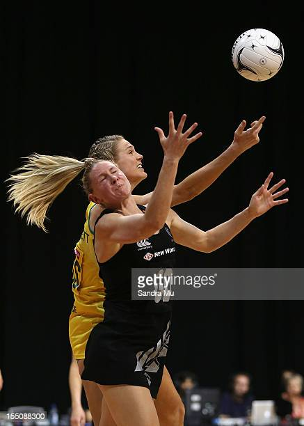 Caitlin Bassett of Australia and Casey Williams of New Zealand in action during the 2012 Quad Series match between the New Zealand Silver Ferns and...