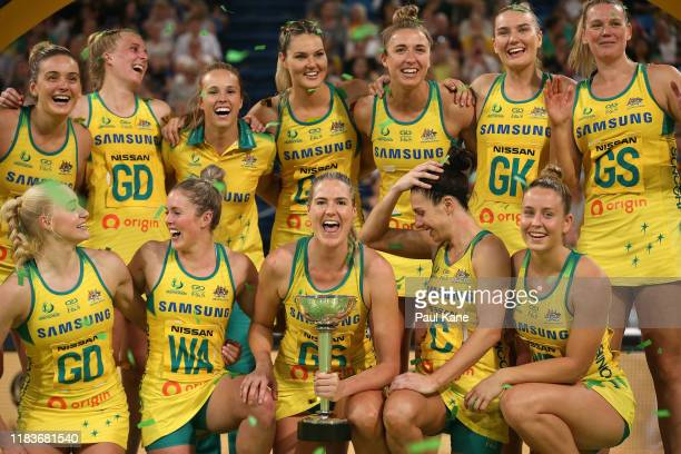 Caitlin Bassett of Australia holds the Constellation Cup and celebrates with team mates after winning the 2019 Constellation Cup match between the...