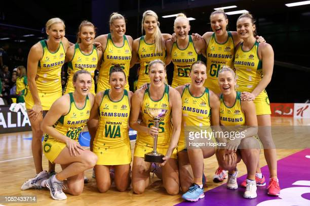 Caitlin Bassett of Australia holds the Constellation Cup with teammates after winning the International Test and Constellation Cup match between the...