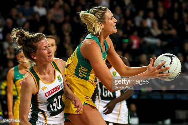 Caitlin Bassett of Australia looks to pass under pressure from Karla Mostert of South Africa during the International Test Match between Australia...