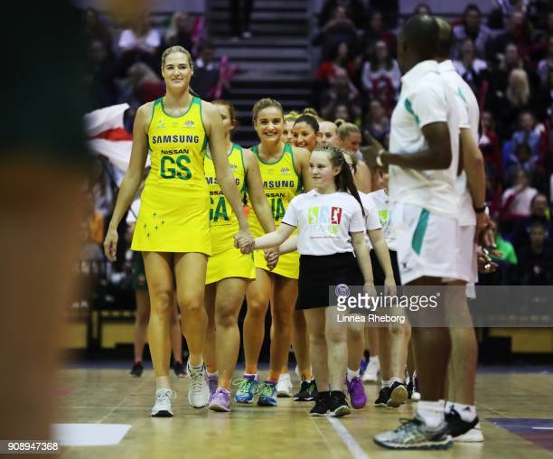 Caitlin Bassett of Australia walks out with her team mates prior to the Netball Quad Series Vitality Netball International match between England and...