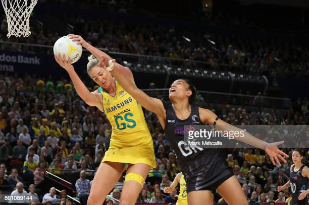 Caitlin Bassett of Australia wins the ball ahead of Temalisi Fahokotau of New Zealand during the 2017 Constellation Cup match between the Australian...