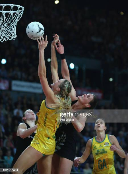 Caitlin Bassett of the Australia Diamonds and Leana de Bruin of the Silver Ferns compete for the ball during the Constellation Cup match between the...