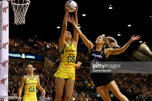 Caitlin Bassett of the Australian Diamonds and Jane Watson of the New Zealand Silver Ferns compete for the ball during the Constellation Cup...