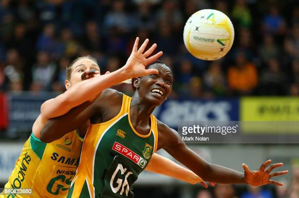 Caitlin Bassett of the Diamonds and Phumza Maweni of the Proteas contest possession during the 2017 Netball Quad Series between the Australia...